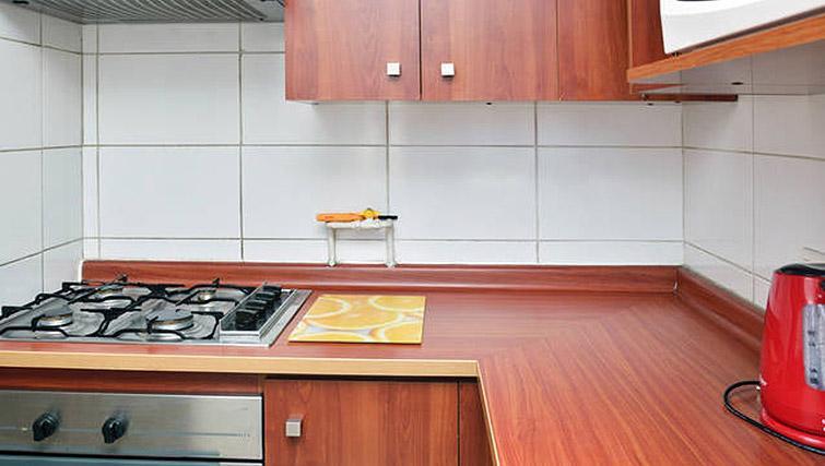 Kitchen at VIP Apartments Chile - Citybase Apartments
