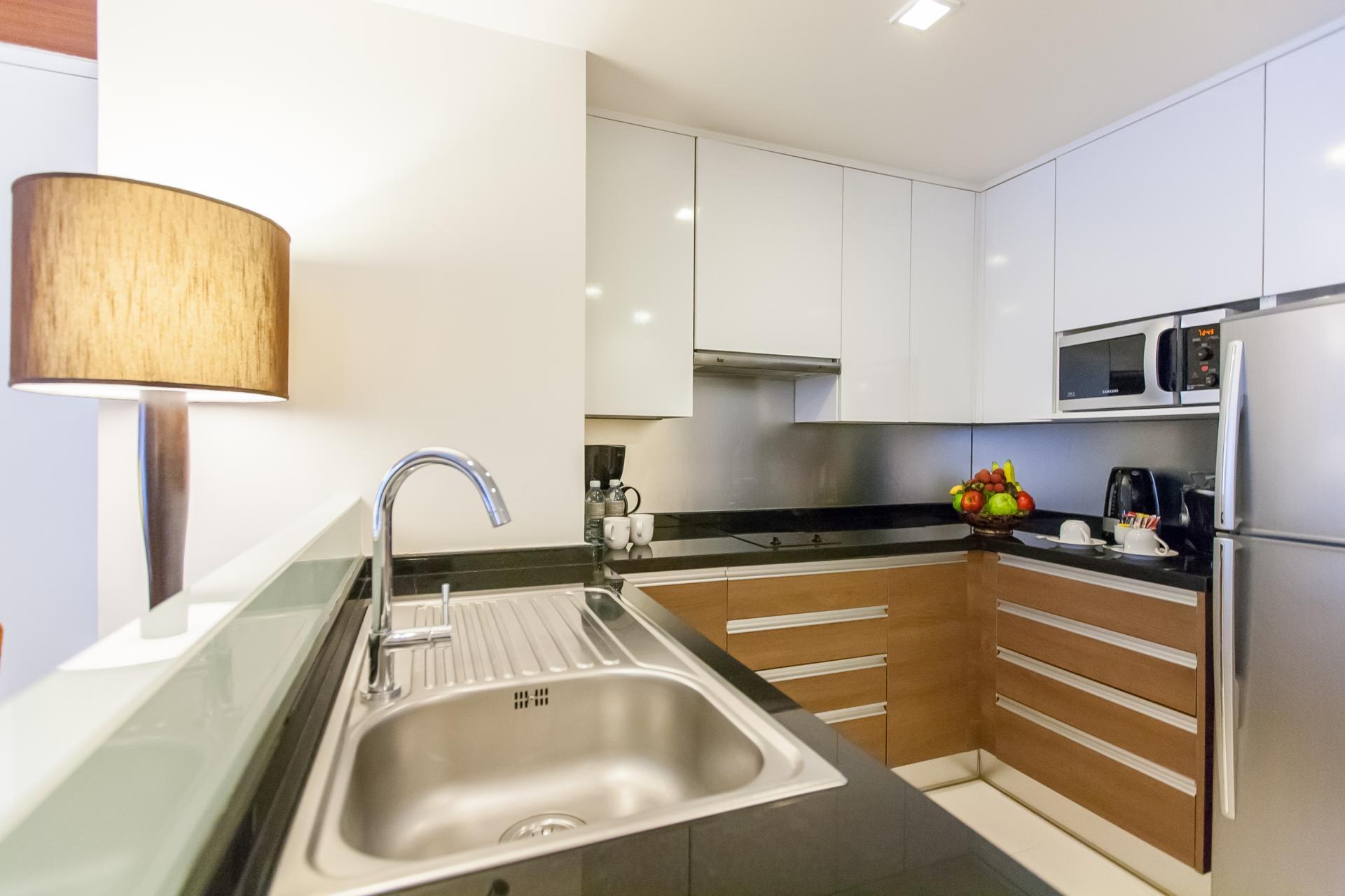 Kitchen at Oakwood Residence Sukhumvit 24 Bangkok - Citybase Apartments
