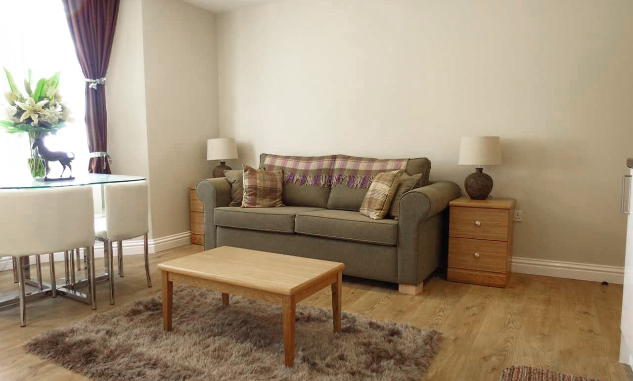 Sofa at Queens Hotel Apartments - Citybase Apartments