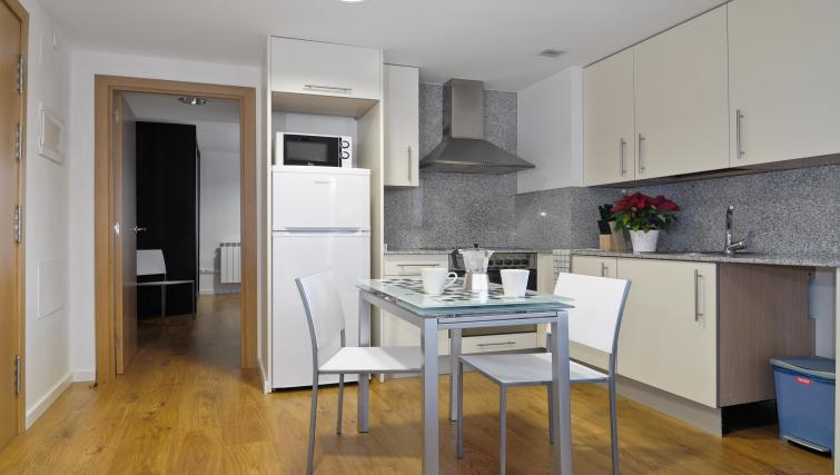 Kitchen and dining area at Palacio Apartments - Citybase Apartments