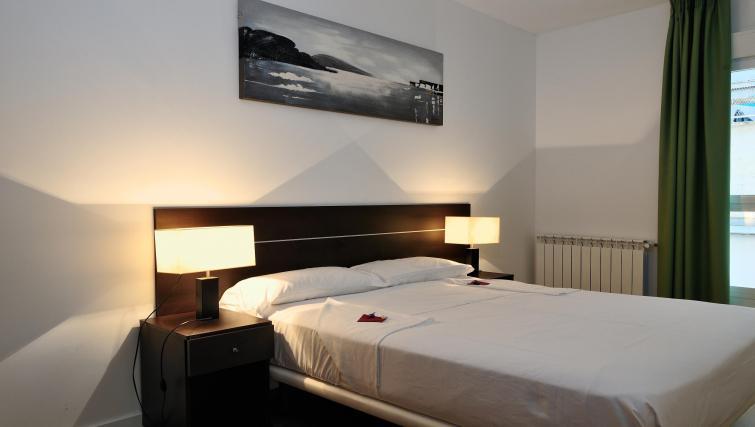 Bed at Palacio Apartments - Citybase Apartments