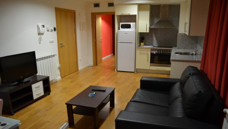 Living and kitchen area at Palacio Apartments - Citybase Apartments