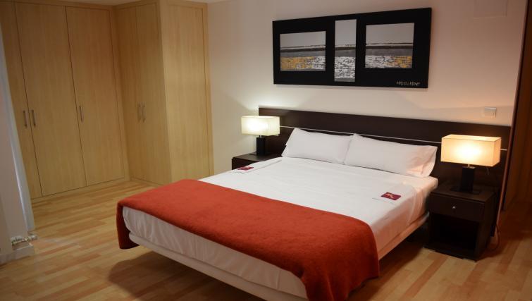Comfortable bed at Palacio Apartments - Citybase Apartments