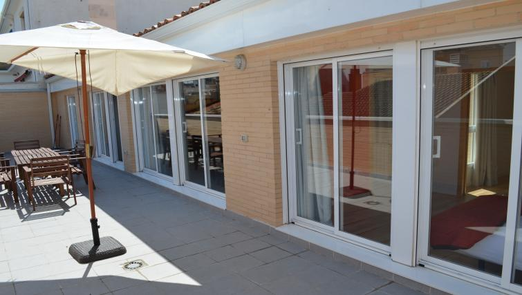 Outdoor lounge area at Palacio Apartments - Citybase Apartments