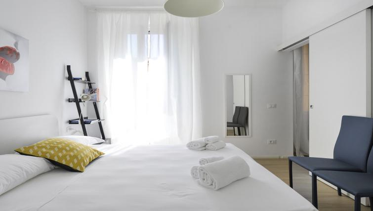 Bed at Goldoni Apartment - Citybase Apartments