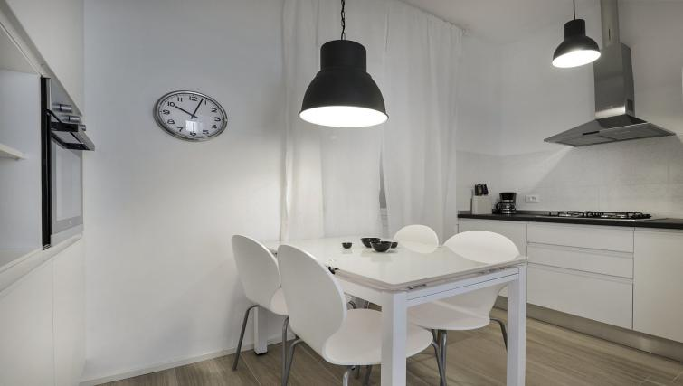 Dining table at Goldoni Apartment - Citybase Apartments