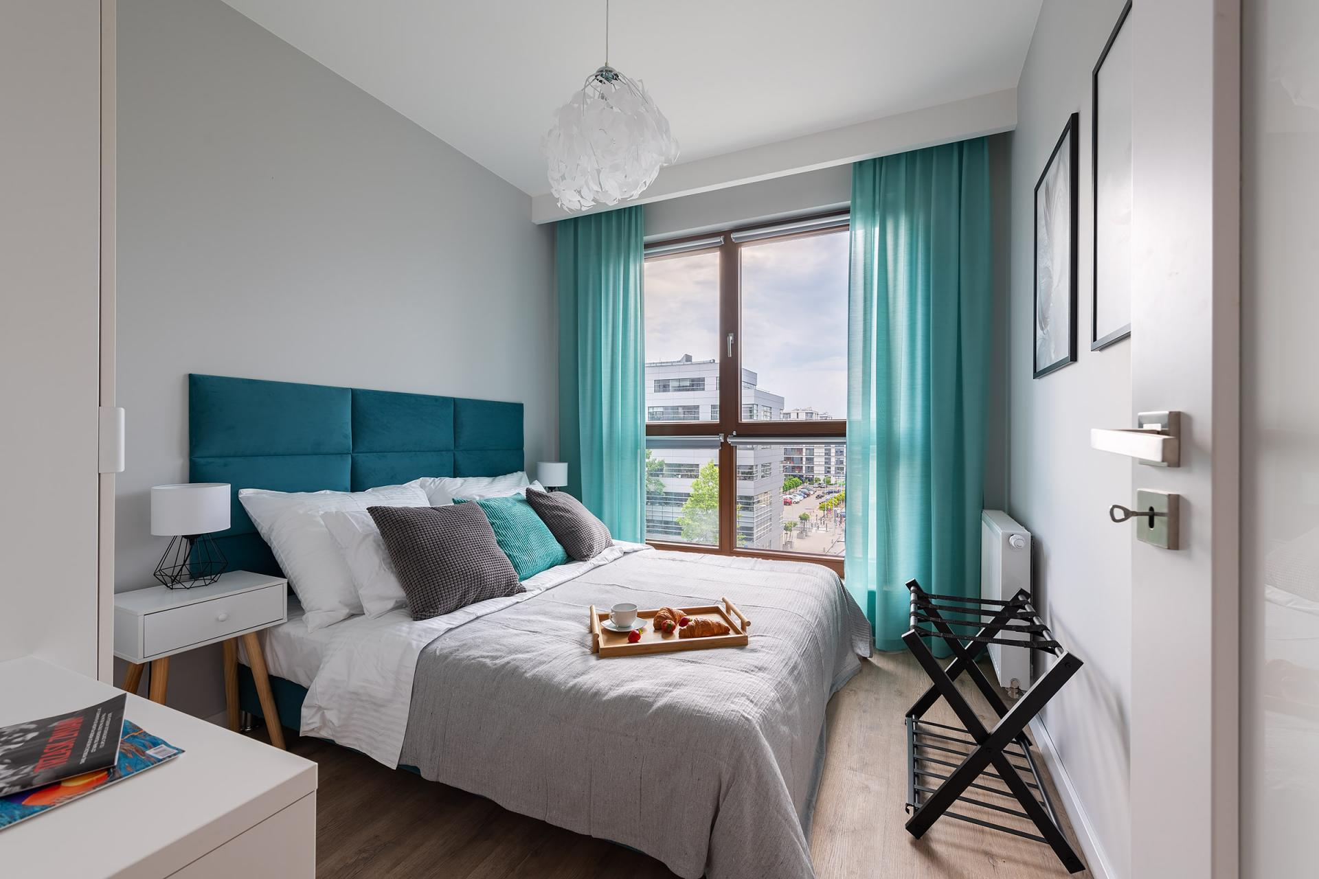 Double bed at Cybernetyki 4 Apartment, Sluzewiec, Warsaw - Citybase Apartments