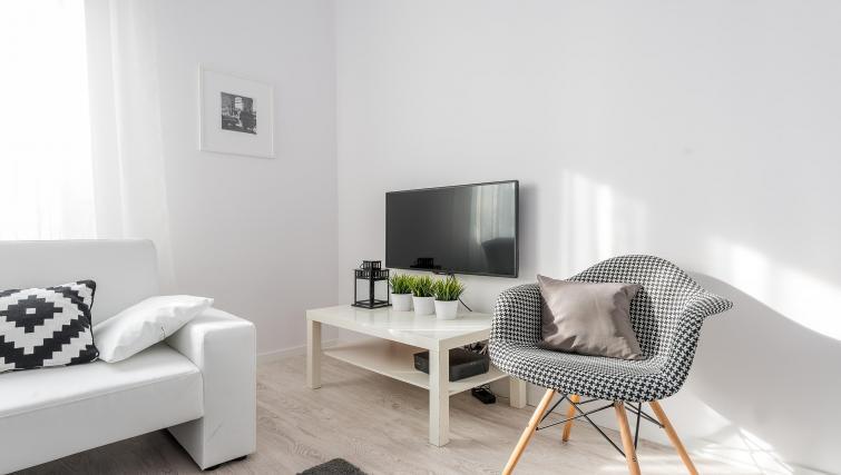 Television at P&O Apartments Andersa - Citybase Apartments