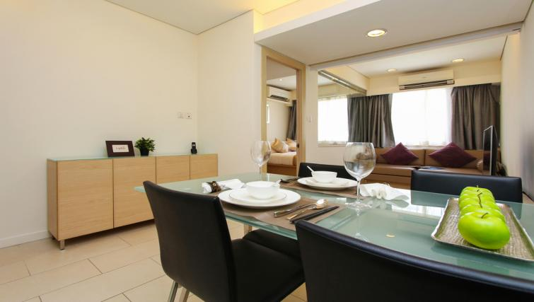 Dining table and chairs at Wan Chai Apartments - Citybase Apartments