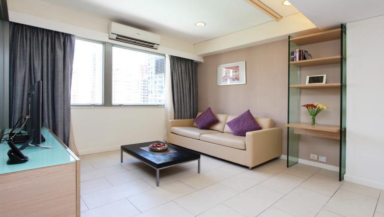 Simplistic living area at Wan Chai Apartments - Citybase Apartments