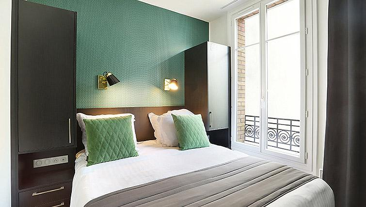 Double bed at Eiffel Village Apartments - Citybase Apartments