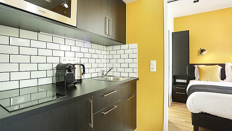 Bright kitchenette at Eiffel Village ApartmentsEiffel Village Apartments - Citybase Apartments