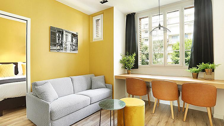 Bright living space at Eiffel Village Apartments - Citybase Apartments
