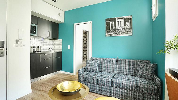 Living area at Eiffel Village Apartments - Citybase Apartments