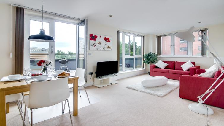 spacious living area at The Class Place Apartment - Citybase Apartments
