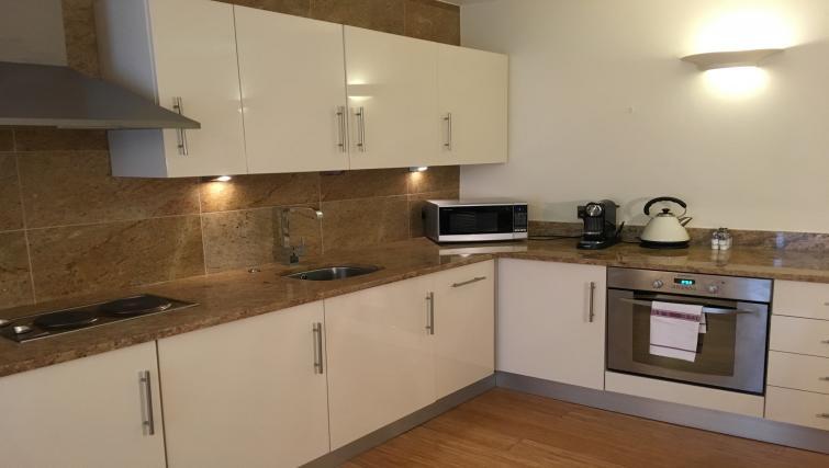 Kitchen at Still Life Monument Executive Apartment - Citybase Apartments