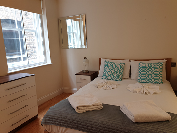 Double bed at Still Life Monument Executive Apartment - Citybase Apartments