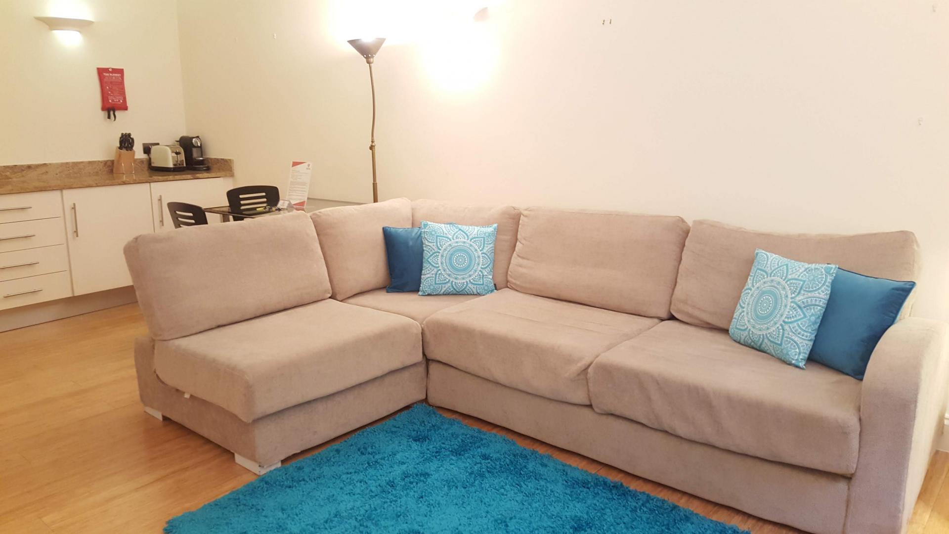 Sofa at till Life Monument Executive Apartment - Citybase Apartments