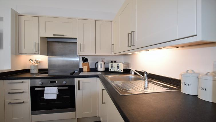 Kitchen at Berkeley Square Apartments - Citybase Apartments