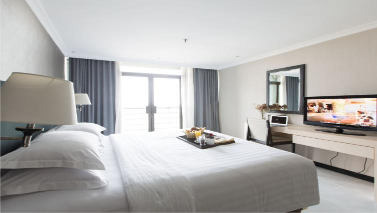 Bedroom at the Hotel Kristal Jakarta - Citybase Apartments