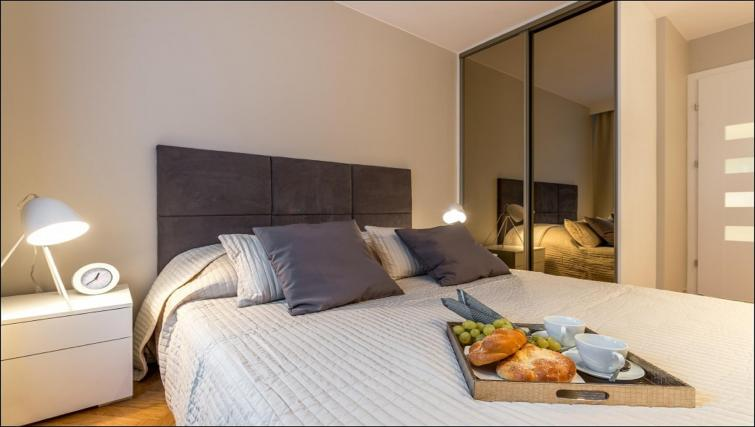 Comfortable bed at Chmielna Apartment - Citybase Apartments