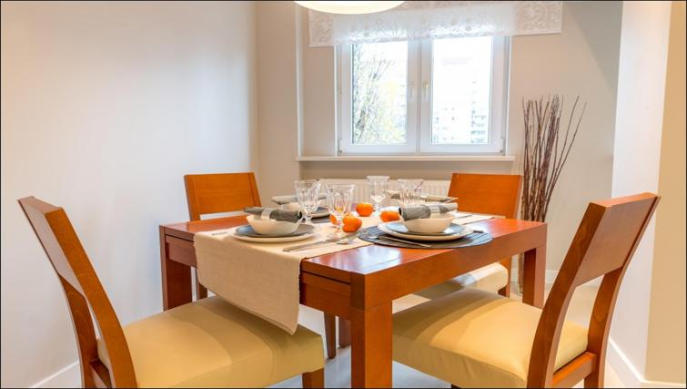 Dining table at Chmielna Apartment - Citybase Apartments