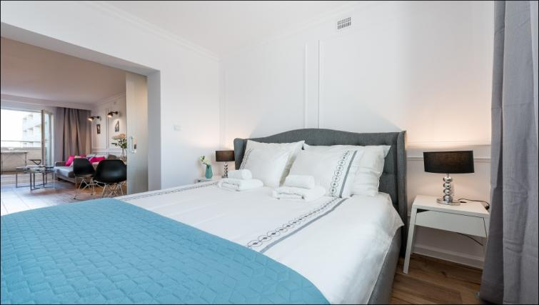 Bedroom at the Emilii Plater Apartments - Citybase Apartments