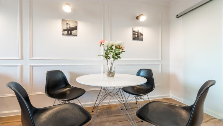Dining area at the Emilii Plater Apartments - Citybase Apartments
