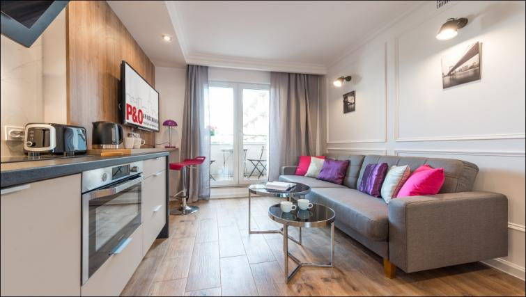 Living room at the Emilii Plater Apartments - Citybase Apartments