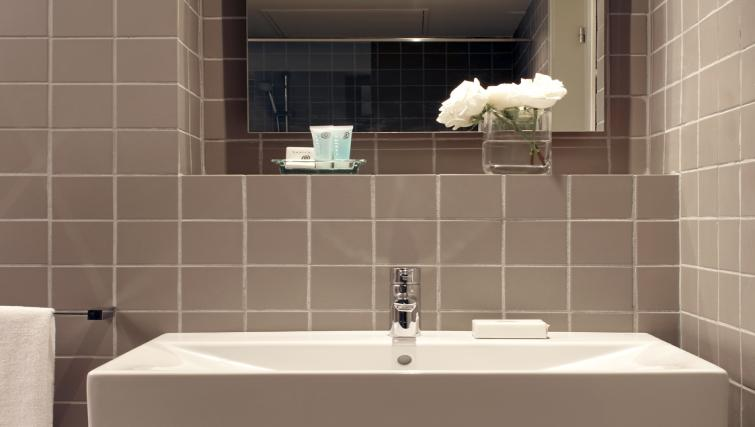 Pristine bathroom at The Urban Suites Barcelona - Citybase Apartments