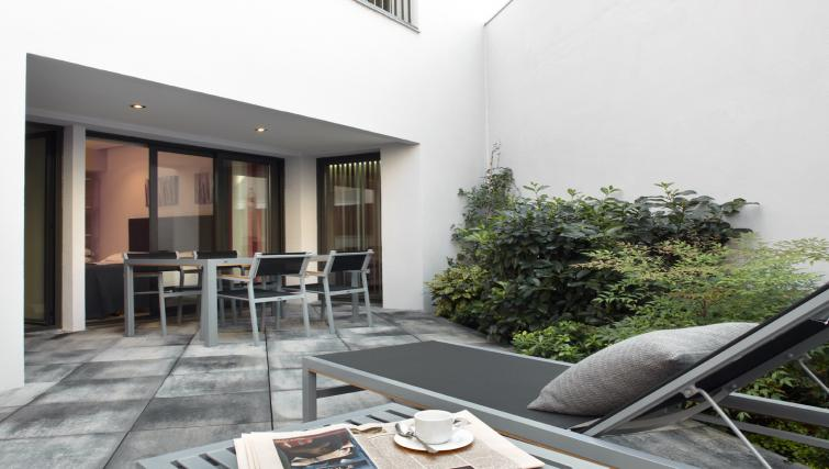 Outdoor lounge area at The Urban Suites Barcelona - Citybase Apartments