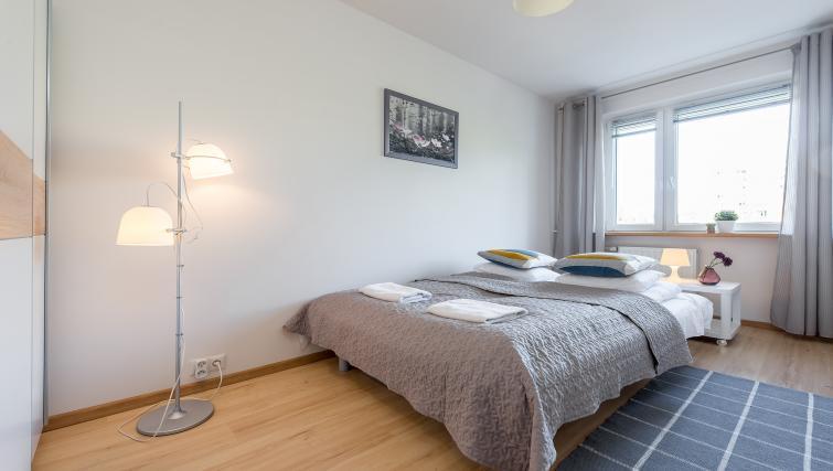 Bright bedroom at Metro Imielin Apartment - Citybase Apartments