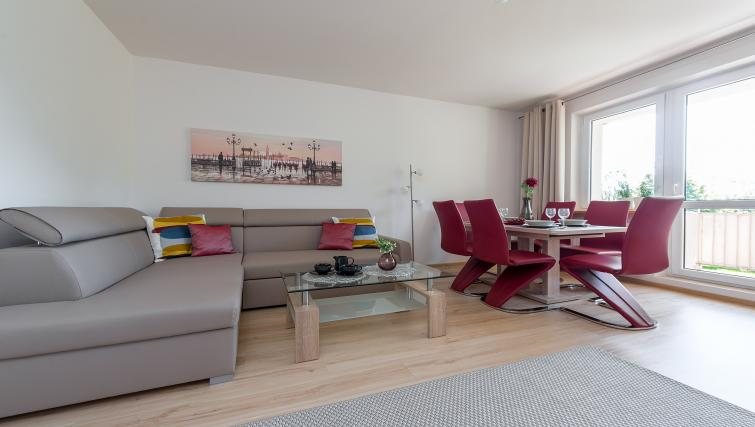 Living room at Metro Imielin Apartment - Citybase Apartments
