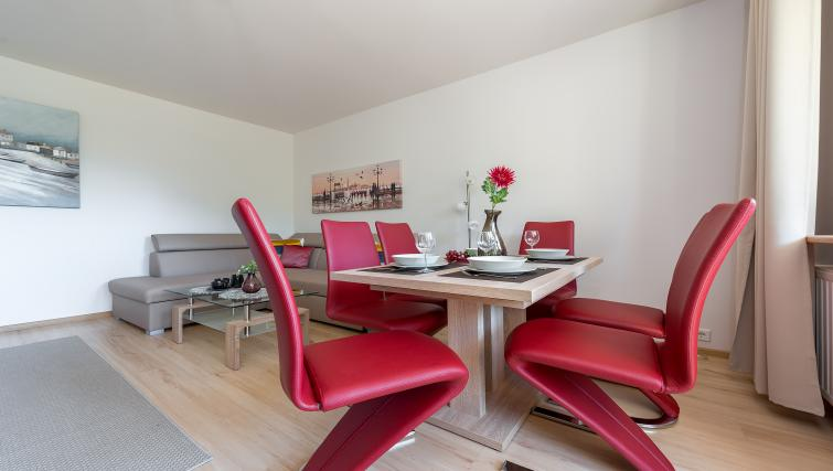 Dining table at Metro Imielin Apartment - Citybase Apartments