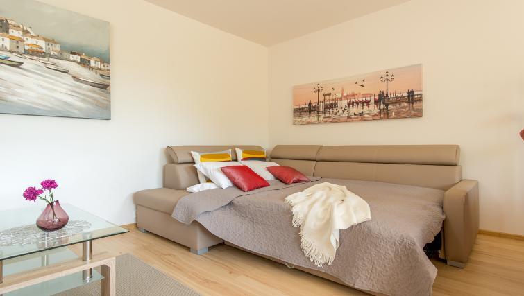 Sofa bed at Metro Imielin Apartment - Citybase Apartments