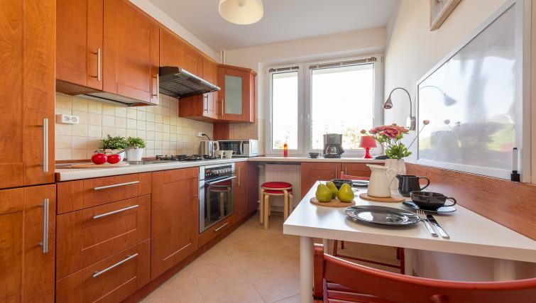 Kitchen at Metro Imielin Apartment - Citybase Apartments