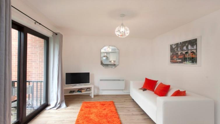 Living area at Flamingo Court Apartment - Citybase Apartments