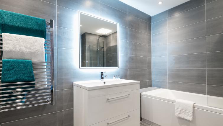 Bathroom at the Bluestone Trinity Apartment - Citybase Apartments