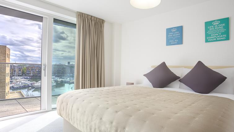 Comfortable bedroom at Flying Butler Limehouse - Citybase Apartments