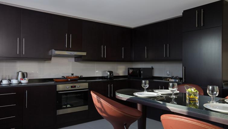 Kitchen at Pullman Dubai Jumeirah Lakes Towers - Citybase Apartments