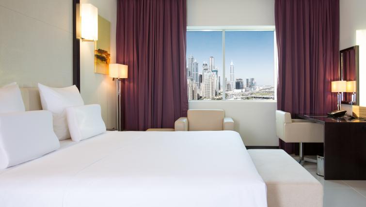 Bedroom at Pullman Dubai Jumeirah Lakes Towers - Citybase Apartments