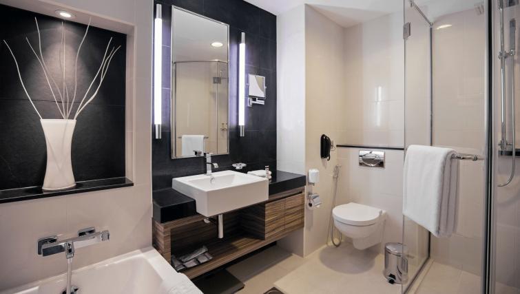Bathroom at Pullman Dubai Jumeirah Lakes Towers - Citybase Apartments