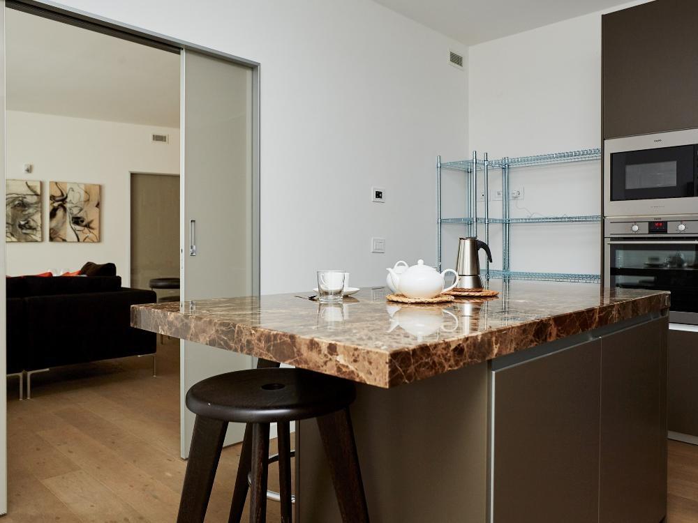 Spacious kitchen at Gorani Apartments, Centre, Milan - Citybase Apartments