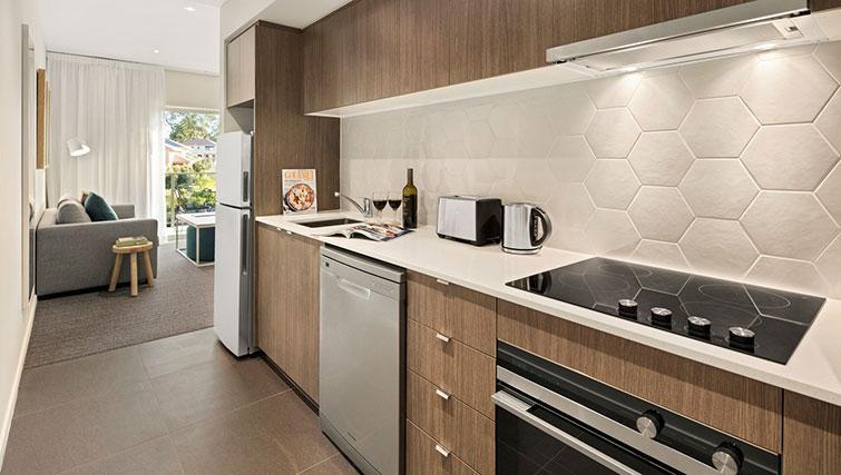 Kitchen at Quest Eight Mile Plains Apartments - Citybase Apartments