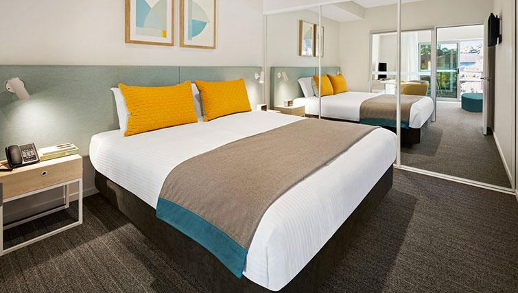 Bed at Quest Eight Mile Plains Apartments - Citybase Apartments