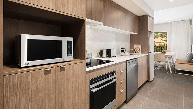 Equipped kitchen at Quest Eight Mile Plains Apartments - Citybase Apartments