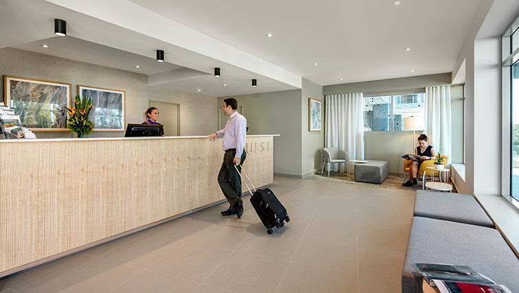 Reception at Quest Eight Mile Plains Apartments - Citybase Apartments