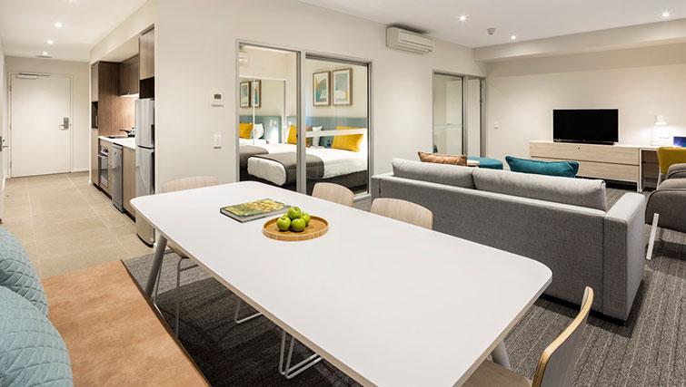 Living area at Quest Eight Mile Plains Apartments - Citybase Apartments
