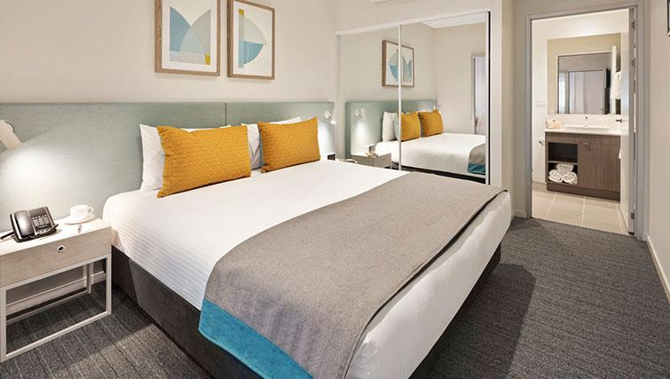 Bedroom at Quest Eight Mile Plains Apartments - Citybase Apartments