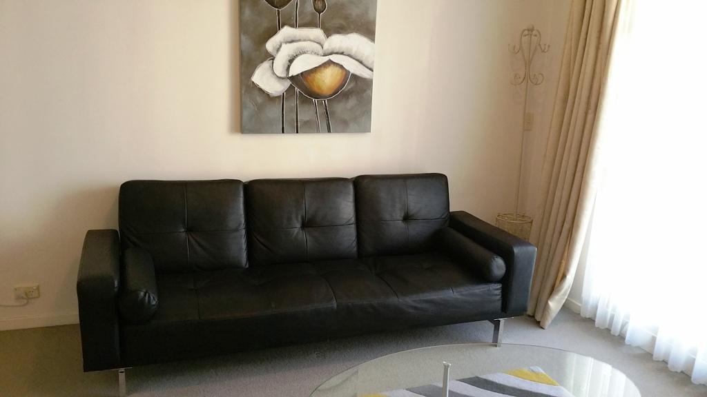 Sofa at Mid Town Sydney Apartments - Citybase Apartments